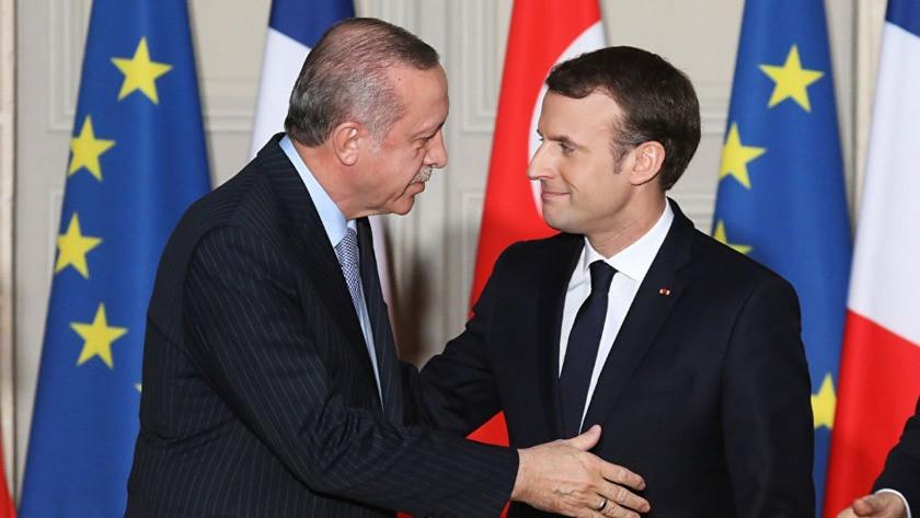 Macron: Erdoğan Berlin'deki taahhütlerine uymuyor
