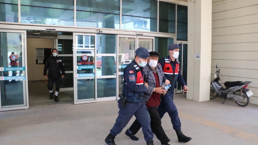 Cinayet zanlısı tutuklanırken gazetecilere tepki gösterdi