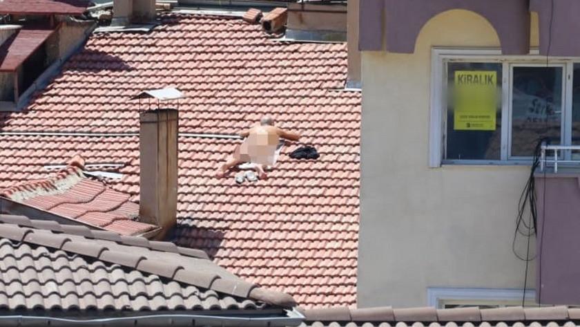 Apartmanın çatısında çıplak güneşlenmek istedi, gözaltına alındı